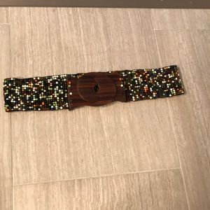 Beaded belt with wooden clasp