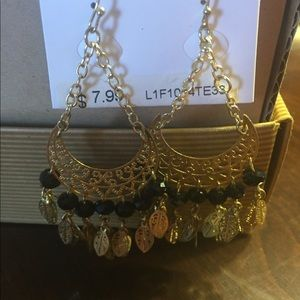 Gold tone and black earrings