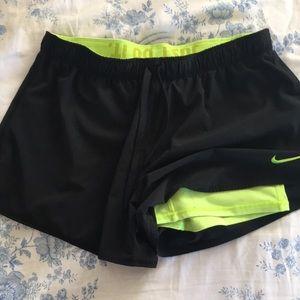 Nike shorts with spandex shorts.