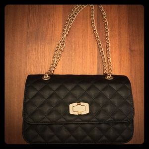 Black quilted flap purse with gold chain link