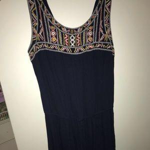 Navy blue romper with multi color detailing.