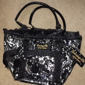 Black floral bag with lace pattern