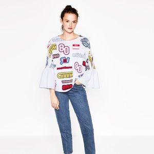 T-shirt with ruffled sleeves (Zara)