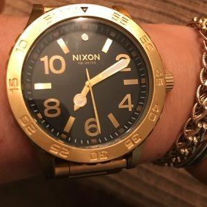 Nixon Black and Gold Watch