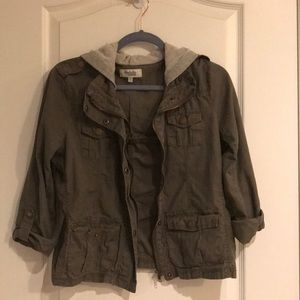 Army green jacket with a grey hood
