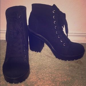Boots, with a thick heel.
