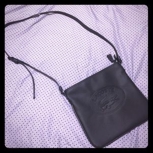 Black leather Lacoste crossbody- like new cond.