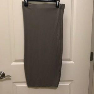 Tan colored midi skirt. New no tags