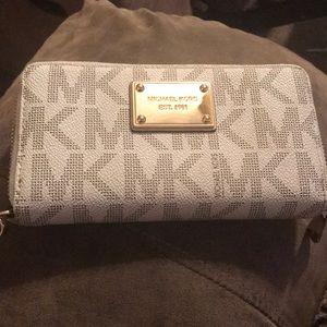 Used Michael Kors wallet . . OBO
