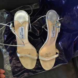 Used Jimmy Choo silver satin sandals.