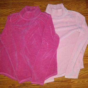 Two Anne Klien pink fleece jackets.