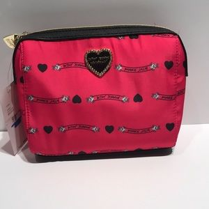 Betsey Johnson hot pink small cosmetic bag.