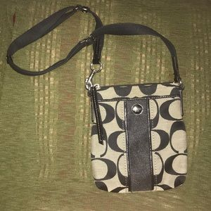 Over the shoulder Coach purse.