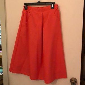 Orange skirt with pockets flowy