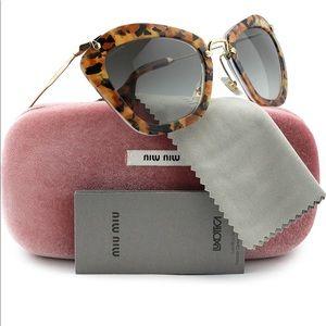 Miu Miu's Cat Eye Sunglasses