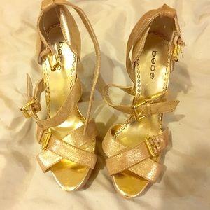 Gold strappy Bebe heels