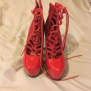 Red lace up privilege heels
