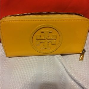 Tory Burch yellow leather wallet.