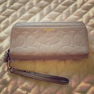 Coach Zip Wallet In Signature Embossed Leather