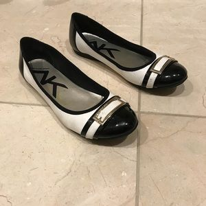 Well loved black and white flats
