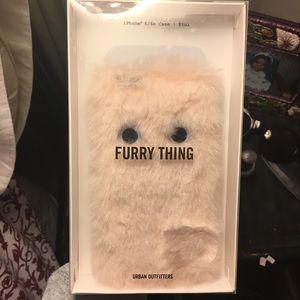 Furry pink googly eyes iPhone case