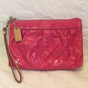 Coach pink wristlet pouch