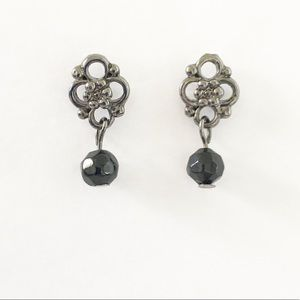 Silver carved earring with bald bead