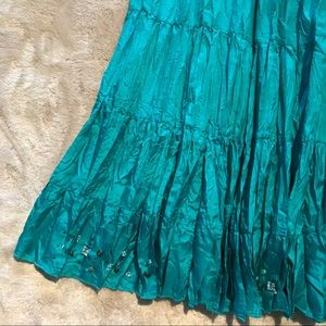 Pleated silk turquoise skirt