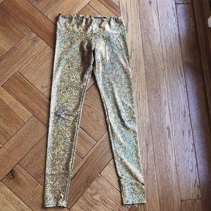 Onzie black gold print yoga leggings m