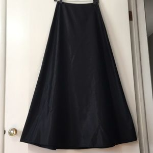 Black satiny a-line skirt for holiday celebrations