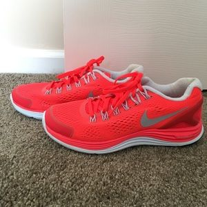 Neon orange tennis shoes