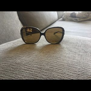 Brown Oakley polarized sunglasses