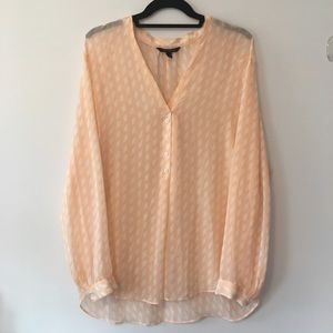 Sheer orange patterned blouse