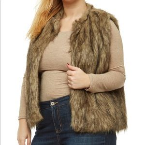 Rainbow faux fur vest with tags, brand new.