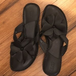 Born black  leather sandals with flower. Size 7