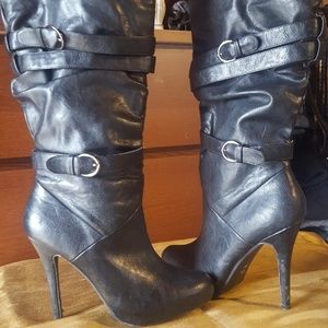 Slouchy straps high heeled boots