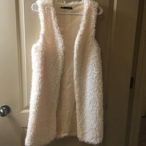 Cute long furry white/cream vest!