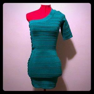 Sparkly green one shoulder mini dress