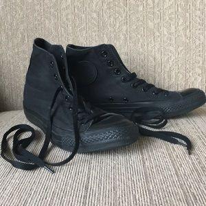 All black Converse Chuck Taylor high tops