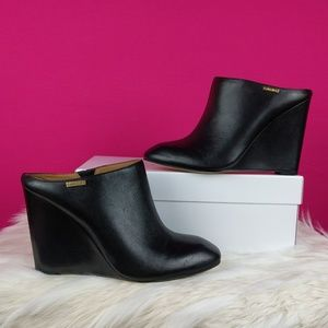 Calvin Klein size 9 black wedge mules leather