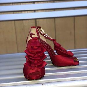Red ruffled heels