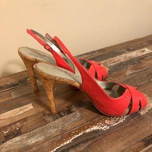 Coral colored heel sandals.
