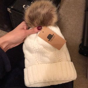 Cream color winter hat with Pom Pom at the top.