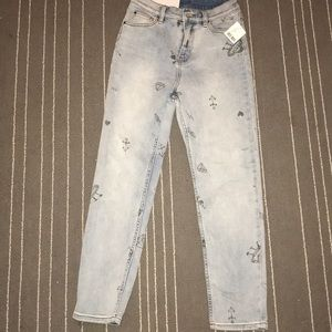 Unworn urban outfitters jeans with trendy print