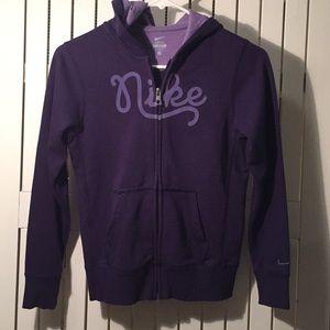 Girl's purple Nike zip-up hoodie.