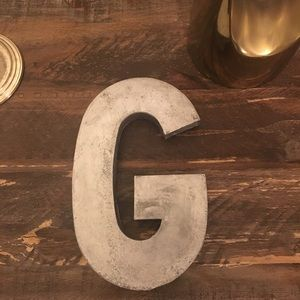 Anthropology decorative letter G