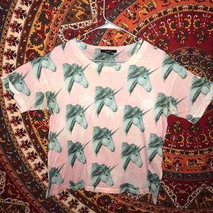 Light pink unicorn blouse.