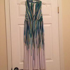 Flattering halter type dress with deep neckline.