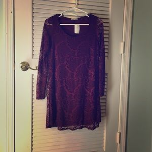 A long-sleeved maroon-colored lace tunic.