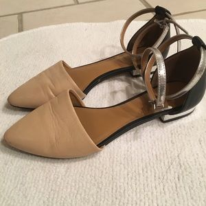 Pointed toe flat with silver ankle ties